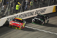 May 2, 2009; Richmond, VA, USA; NASCAR Sprint Cup Series driver Jeff Gordon (24) leads Denny Hamlin (11) during the Russ Friedman 400 at the Richmond International Raceway. Mandatory Credit: Mark J. Rebilas-