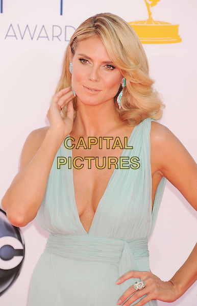 Heidi Klum.The 64th Annual Primetime Emmy Awards held at Nokia Theatre L.A. Live in Los Angeles, California, USA..September 23rd, 2012.emmys half length sleeveless sheer earrings blue pale turquoise cleavage low cut neckline hand on hip arm.CAP/ROT/TM.© TM/Roth/Capital Pictures