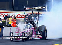 Oct 4, 2013; Mohnton, PA, USA; NHRA top fuel dragster driver Brittany Force gets a little sideways after her burnout during qualifying for the Auto Plus Nationals at Maple Grove Raceway. Mandatory Credit: Mark J. Rebilas-