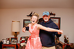 Larry Klein poses with his granddaughter while she plays dress-up in a vintage bridesmaid dress her grandmother Jeannie found in a closet, seen inside their Sun City, Arizona home November 30, 2013.