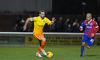 Paul Hayes of Wycombe Wanderers on the ball under pressure from Luke Gutteridge of Dagenham & Redbridge during the Sky Bet League 2 match between Dagenham and Redbridge and Wycombe Wanderers at the London Borough of Barking and Dagenham Stadium, London, England on 9 February 2016. Photo by Andy Rowland.