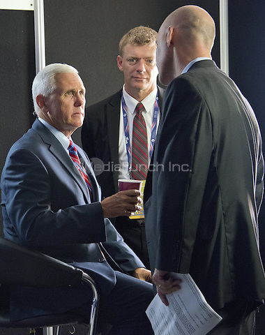 Governor Mike Pence (Republican of Indiana) speaks to aides as he sits for a series of interviews prior to the start of the last session of the 2016 Republican National Convention held at the Quicken Loans Arena in Cleveland, Ohio on Thursday, July 21, 2016.<br /> Credit: Ron Sachs / CNP/MediaPunch<br /> (RESTRICTION: NO New York or New Jersey Newspapers or newspapers within a 75 mile radius of New York City)