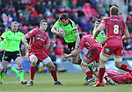 Munster centre Denis Hurley tries to force his way through the Scarlets defence.<br /> Guiness Pro12<br /> Scarlets v Munster<br /> 21.02.15<br /> ©Steve Pope -SPORTINGWALES
