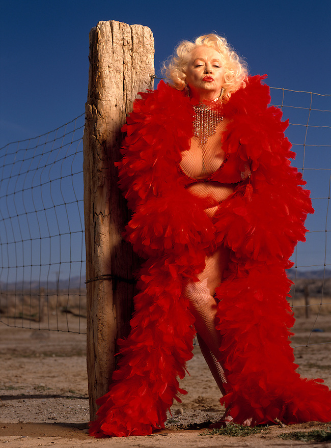 "Legendary Burlesque dancer Dixie Evans, known as the ""Marilyn Monroe of Burlesque"" photographed at ""Exotic World"" the strippers museum she runs in Helendale, Calfornia on March 20, 1993"