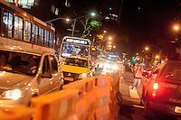 RIO DE JANEIRO, RJ, 20.06.2014 - PROTESTO - Manifestantes se reuniram para ato que lembra um ano do protesto do dia vinte de junho de 2013, quando mais de um milhão de pessoas foram à Avenida Presidente Vargas, no Centro do Rio de Janeiro. No início do ato, cinco ativistas foram presos e levados para diversas delegacias. Jornalistas foram revistados e obrigados a abrir as mochilas. Na Lapa, manifestantes entraram em confronto com policiais do Batalhão de Choque, obrigando comerciantes a fecharem as portas.. foto: Nicson Olivier/Brazil Photo Press