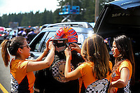 Aug. 1, 2014; Kent, WA, USA; Crew members help NHRA top fuel dragster driver Mike Salinas get dressed in his safety gear during qualifying for the Northwest Nationals at Pacific Raceways. Mandatory Credit: Mark J. Rebilas-