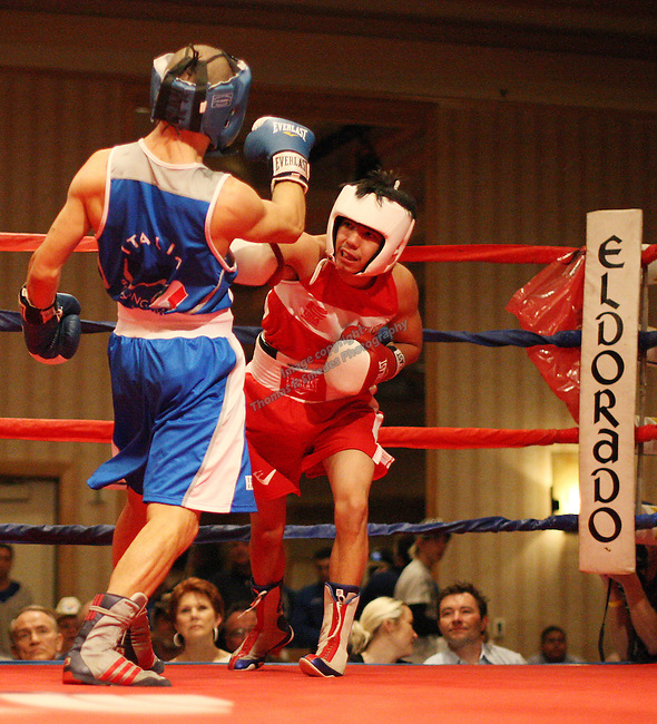 112 pound weight class USA's Louie Byrd (red) vs Alex Feramosca. USA vs Italy International Boxing Dual at the Eldorado Convention Center on April 2 . Photos by Tom Smedes