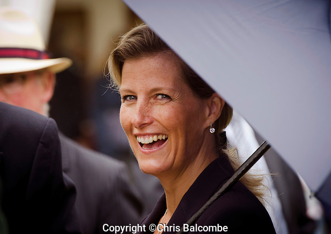 A radiant Sophie, Countess of Wessex beams through the rain, from under an umbrella, at the New Forest Show in Hampshire<br />