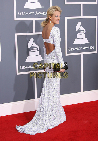 Carrie Underwood.The 54th Annual GRAMMY Awards held at the Staples Center, Los Angeles, California, USA..February 12th, 2012.full length white beads beaded dress long sleeves clutch bag black silver side backless strap back behind rear.CAP/ADM.©AdMedia/Capital Pictures.