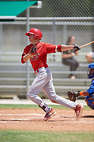 GCL Cardinals shortstop Mateo Gil (16) follows through on a swing during a game against the GCL Mets on August 6, 2018 at Roger Dean Chevrolet Stadium in Jupiter, Florida.  GCL Cardinals defeated GCL Mets 6-3.  (Mike Janes/Four Seam Images)