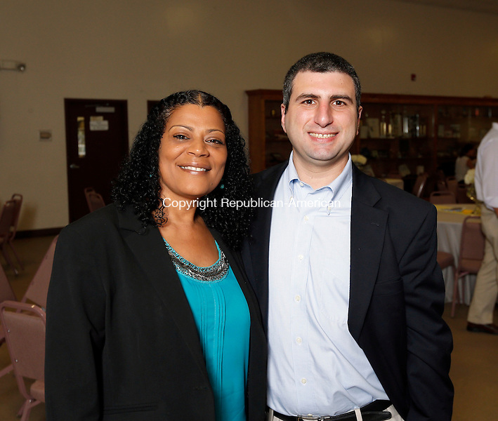 Waterbury, CT- 04 June 2015-060415CM10-  Social moments, from left: GiGi Cuffee, MST Therapist from Danbury and Daniel Pace, with Waterbury Connecticut Junior Republic, are photographed during The Connecticut Junior Republic's 14th Annual Scholarship Dinner at Fantina Hall in Waterbury on Thursday June 04, 2015.    Christopher Massa Republican-American