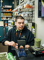 Pete Vasquez (cq) bags marijuana at the Medicine Man grow house and dispensary in Denver, Colorado, Tuesday, March 5, 2013. With Colorado's Amendment 64, the state has been working to decide how it will transition to legalized marijuana in the state...Photo by Matt Nager