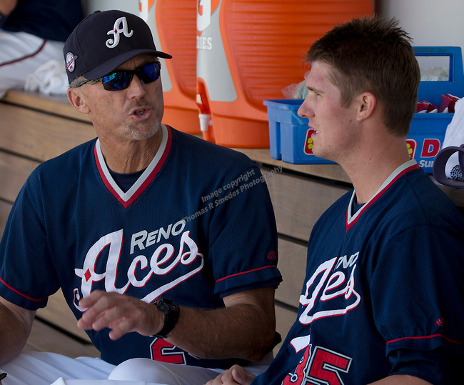 Reno Aces pitching coach Mike Parrott talks with pitcher Charles Brewer between innings during their game against the Tacoma Rainiers played on Sunday afternoon, May 26, 2013 in Reno, Nevada.