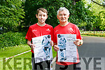 Oisin Murray and John Conway celebrate their 100th Park Run on Saturday