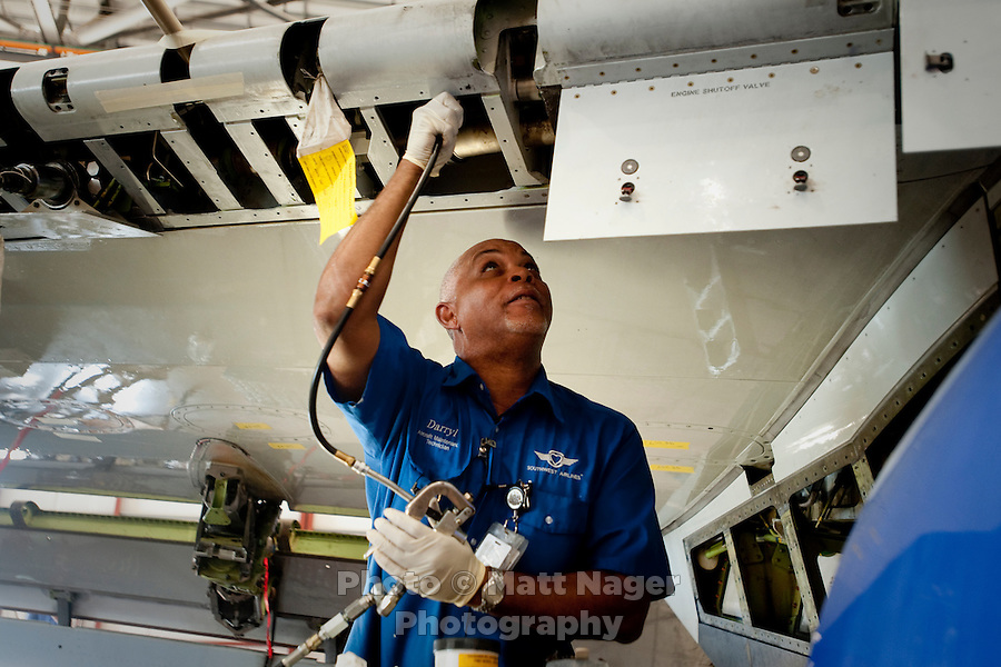 Darryl Sample (cq) works on a wing at the Southwest Airlines maintenance facility at Love Field Airport in Dallas, Texas, Wednesday, October 27, 2010...PHOTO/ MATT NAGER