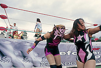 Marcela looks for sugestions from the crowd for what to do with Amapola.  women's wrestling match (Lucha Libre) in Ecatepec, Estado de Mexico.  June 2004