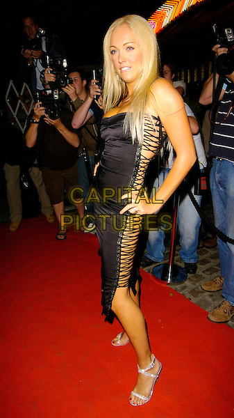 AISLEYNE HORGAN WALLACE.The BB7 wrap party, Gilgamesh restaurant, London, UK..August 21st, 2006.Ref: CAN.Big Brother full length black dress lace up skin hands on hip.www.capitalpictures.com.sales@capitalpictures.com.©Can Nguyen/Capital Pictures