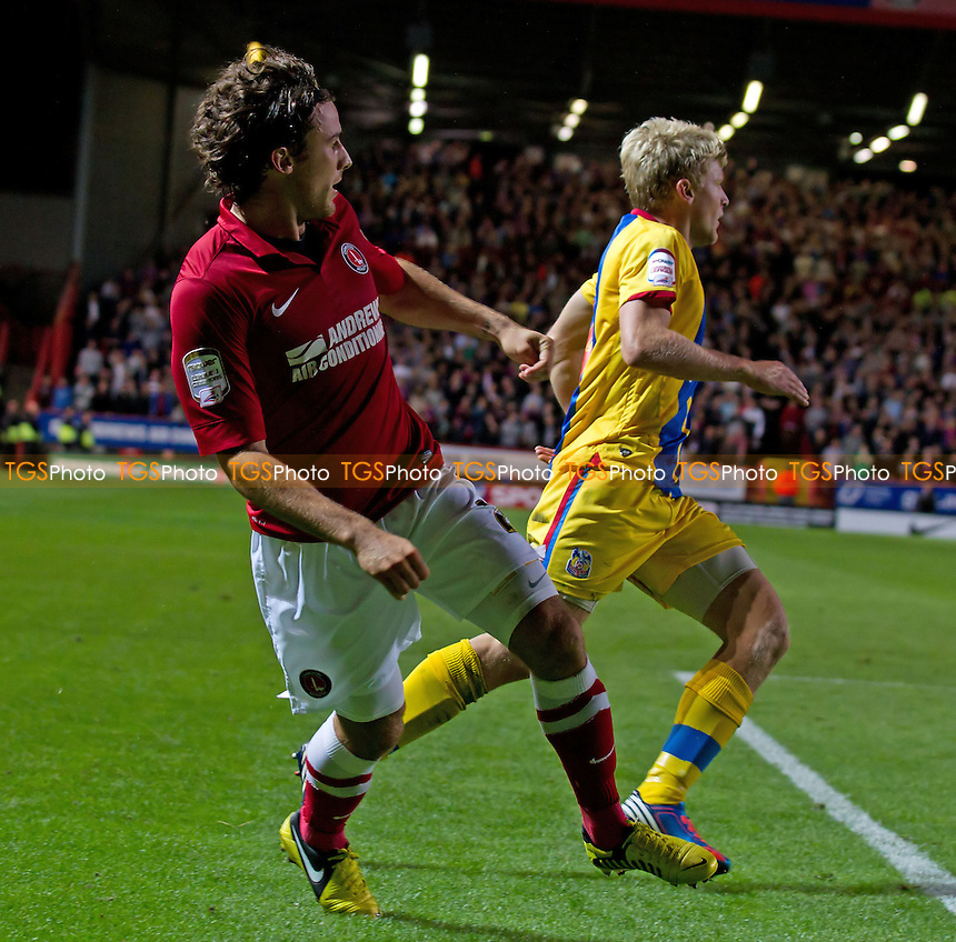 Lawrie Wilson, Charlton Athletic FC gets in his cross under pressure from Jonathon Parr, Crystal Palace FC - Charlton Athletic vs Crystal Palace - NPower Championship Football at The Valley, London - 14/09/12 - MANDATORY CREDIT: Ray Lawrence/TGSPHOTO - Self billing applies where appropriate - 0845 094 6026 - contact@tgsphoto.co.uk - NO UNPAID USE.