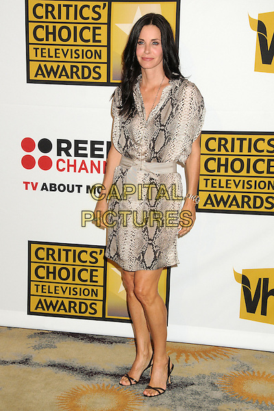 Courteney Cox .1st Annual Critics' Choice Television Awards held at The Beverly Hills Hotel, Beverly Hills, California, USA, .20th June 2011..full length dress  shirt belt black strappy sandals  snakeskin print snake animal beige grey gray necklace .CAP/ADM/BP.©Byron Purvis/AdMedia/Capital Pictures.