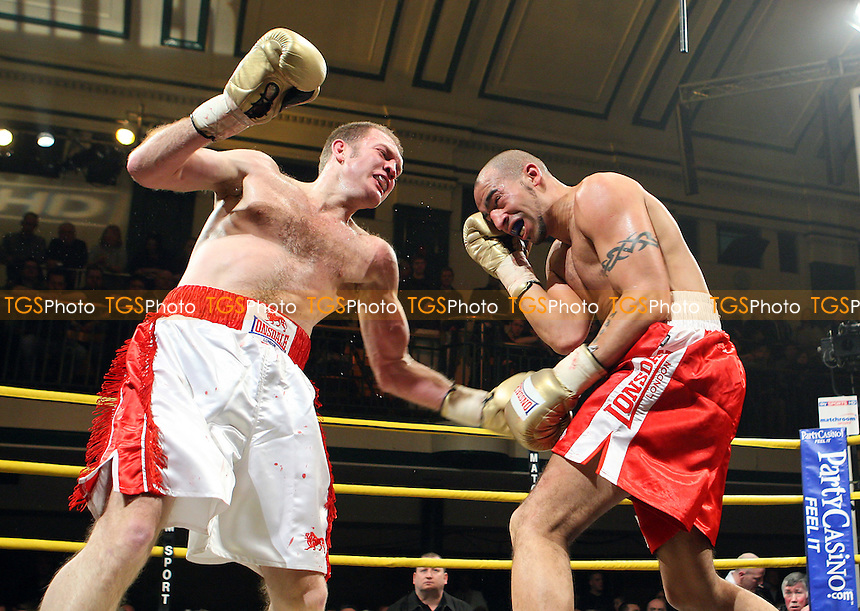Bradley Pryce (red shorts) defeats Neil Sinclair in the Quarter-Final of Prizefighter 'The Light Middleweights' at York Hall, Bethnal Green, promoted by Matchroom Sports / Barry Hearn - 26/02/10 - MANDATORY CREDIT: Gavin Ellis/TGSPHOTO - Self billing applies where appropriate - Tel: 0845 094 6026