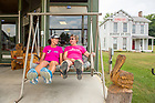August 16, 2017; Pilgrims  Nancy​ ​Majerek and Suzanna Carney (right) relax after lunch on the front porch at Collom's General Store in Bridgeton, Indiana. On day 3 of the ND Trail, the pilgrims biked 23.2 miles and walked 7.8 from Pimento to Bridgeton. As part of the University's 175th anniversary celebration, the Notre Dame Trail will commemorate Father Sorin and the Holy Cross Brothers' journey. A small group of pilgrims will make the entire 300+ mile journey from Vincennes to Notre Dame over  two weeks. (Photo by Barbara Johnston/University of Notre Dame)
