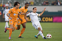 LA Galaxy midfielder Landon Donovan (10) is marked tightly by Puerto Islanders Noah Delgado (5) and Christopher Nurse (8). The Puerto Rico Islanders defeated the LA Galaxy 4-1 during CONCACAF Champions League group play at Home Depot Center stadium in Carson, California on Tuesday July 27, 2010.