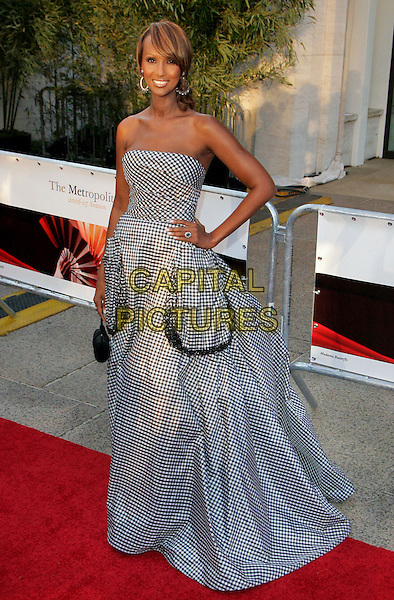 """IMAN.At """"Madama Butterfly"""" Opening Night Starting the Lincoln Center Metropolitan Opera 2006-2007 Season, New York, NY, USA..September 25th, 2006.Ref: ADM/JL.full length black white checkered pattern dress gown hand on hip strapless pockets.www.capitalpictures.com.sales@capitalpictures.com.©Jackson Lee/AdMedia/Capital Pictures."""