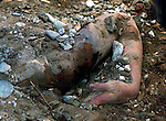 1/28/99 AL DIAZ/HERALD STAFF--COLOMBIAN EARTHQUAKE, The body of a women is uncovered by Miami-Dade Fire Rescue. Armenia