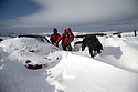 01/02/15<br /> <br /> After more overnight snow hikers and their dog trudge past a car buried in snowdrifts on Rushup Edge near Chapel-en-le-Frith in the Derbyshire Peak District.<br /> <br /> All Rights Reserved - F Stop Press.  www.fstoppress.com. Tel: +44 (0)1335 418629 +44(0)7765 242650