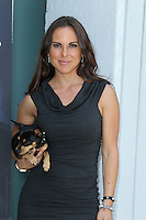 Kate del Castillo with her dog Lola during the PETA billboard 'Fiercely Protect Your Animals' unveiling ceremony at The Bob Barker Building on May 10, 2012 in Los Angeles, California. © mpi27/MediaPunch Inc