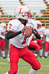 Palos Verdes, CA 09/30/11 - Isiah Simon (Lawndale #7) in action during the Lawndale-Peninsula Varsity football game.