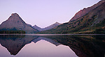 The purple twilight illuminates Mt. Sinopah in Glacier National Park, Montana along the shores of Two Medicine Lake.