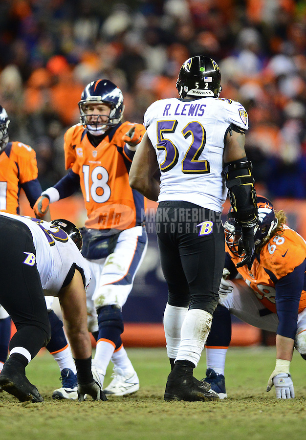 Jan 12, 2013; Denver, CO, USA; Baltimore Ravens linebacker Ray Lewis (52) looks on as Denver Broncos quarterback Peyton Manning (18) calls a play during the AFC divisional round playoff game at Sports Authority Field.  The Ravens defeated the Broncos 38-35 in double overtime. Mandatory Credit: Mark J. Rebilas-