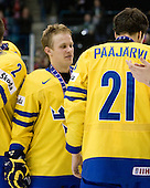Mattias Tedenby (Sweden - 9). - Team Sweden celebrates after defeating Team Switzerland 11-4 to win the bronze medal in the 2010 World Juniors tournament on Tuesday, January 5, 2010, at the Credit Union Centre in Saskatoon, Saskatchewan.