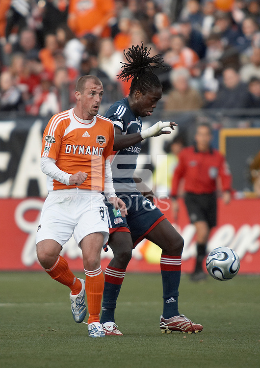 New England Revolution midfielder Shalrie Joseph (21) attempts to steal the ball from Houston Dynamo forward Paul Dalglish (6).  The Houston Dynamo win MLS Cup 2006 over the New England Revolution after playing to a 1-1 tie during regulation and extra time at Pizza Hut Park in Frisco, TX on November 12, 2006.