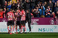 Lincoln City's Shay McCartan, third in from left, celebrates scoring the opening goal with team-mates, from left, Harry Anderson, Bruno Andrade and John Akinde<br /> <br /> Photographer Chris Vaughan/CameraSport<br /> <br /> The EFL Sky Bet League Two - Lincoln City v Cheltenham Town - Saturday 13th April 2019 - Sincil Bank - Lincoln<br /> <br /> World Copyright &copy; 2019 CameraSport. All rights reserved. 43 Linden Ave. Countesthorpe. Leicester. England. LE8 5PG - Tel: +44 (0) 116 277 4147 - admin@camerasport.com - www.camerasport.com