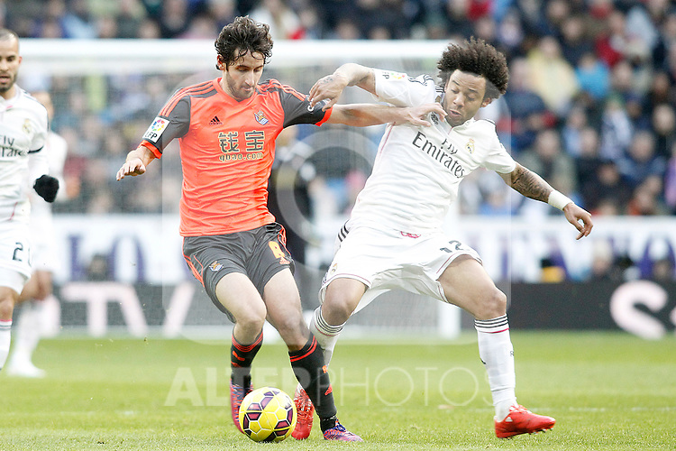 Real Madrid's Marcelo Vieira (r) and Real Sociedad's Esteban Granero during La Liga match.January 31,2015. (ALTERPHOTOS/Acero)