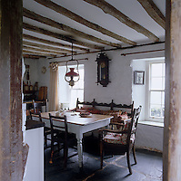 With its wooden table and slate floor the kitchen is typical of a traditional Welsh farmhouse