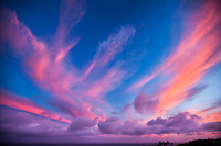 Windswept, vivid clouds top a sunset seen from Hawai'i Loa Ridge, East Honolulu, O'ahu.