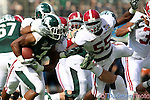 Michigan State Spartans running back Edwin Baker (4) has one arm around his neck Alabama Crimson Tide linebacker Chavis Williams (55) comes in for the finish. Alabama leads at halftime 28-0.