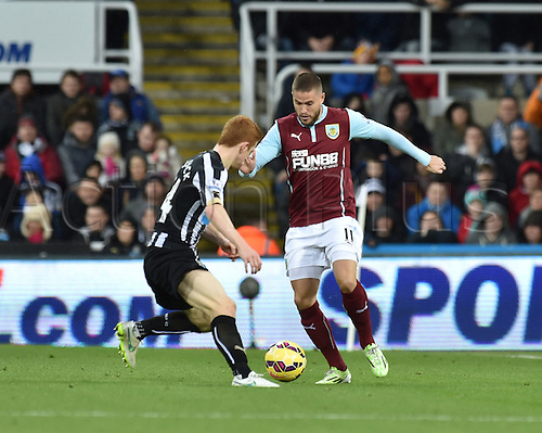 01.01.2015.  Newcastle, England. Barclays Premier League. Newcastle versus Burnley. Jack Colback of Newcastle United challenges Michael Kightly of Burnley