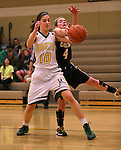 Manogue's Katelyn Oppio and Galena's Kaitlyn Hawthonre battle for a loose ball at Manogue High School in Reno, Nev., on Tuesday, Feb. 11, 2014. Manogue won 51-29.<br /> Photo by Cathleen Allison