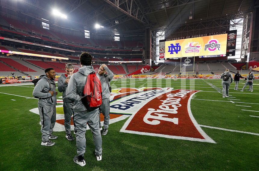 Members of Ohio State's scout team arrive early to University of Phoenix Stadium prior to the Battlefrog Fiesta Bowl against the Notre Dame Fighting Irish in Glendale, Arizona on Jan. 1, 2016. (Adam Cairns / The Columbus Dispatch)