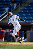 Staten Island Yankees third baseman Andres Chaparro (26) follows through on a swing during a game against the Lowell Spinners on August 22, 2018 at Richmond County Bank Ballpark in Staten Island, New York.  Staten Island defeated Lowell 10-4.  (Mike Janes/Four Seam Images)