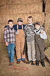 Families gather after Christmas at the Cuneo Ranch in California's Mother Lode--four boys.