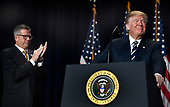 United States President Donald J. Trump accepts applause from US Representative Randy Hultgren (Republican of Illinois), left, during the National Prayer Breakfast, February 8, 2018, in Washington, DC. Thousands from around the world attend the annual ecumenical gathering and every president since President Dwight Eisenhower has addressed the event. <br /> Credit: Mike Theiler / Pool via CNP