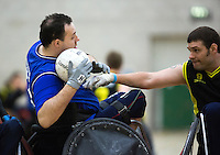 27 MAY 2013 - DONCASTER, GBR - Ross Morrison (left) of Kent Crusaders battles to keep the ball from Justin Frishberg of Stoke Mandeville Storm during their 2013 Great Britain Wheelchair Rugby Nationals final at The Dome in Doncaster, South Yorkshire .(PHOTO (C) 2013 NIGEL FARROW)