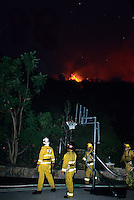 870000336 fire crews work through the night to contain the topanga wildfire as it threatens neighborhood homes in the agoura hills in los angeles county california