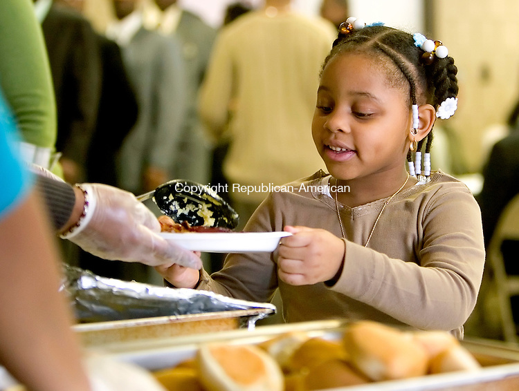 WATERBURY, CT-- 20 JANUARY 2008--012008JS12-Da'nayah Harris, 4, of Waterbury, gets some breakfast served to her during to the annual Martin Luther King, Jr. Memorial Breakfast Sunday at the Mount Olive African Methodist Episcopal Zion Church in Waterbury. <br /> Jim Shannon/Republican-American