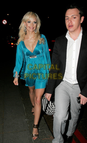 SEPTEMBER (Petra Eos Marklund) .Leaving the Sony Radio Academy Awards 2009, Grosvenor House Hotel, Park Lane, London, England..May 11th, 2009.full length blue dress cleavage gold sandals.CAP/AH.©Adam Houghton/Capital Pictures.